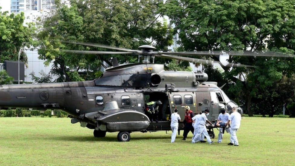 A Singapore Air Force helicopter transports wounded to hospital