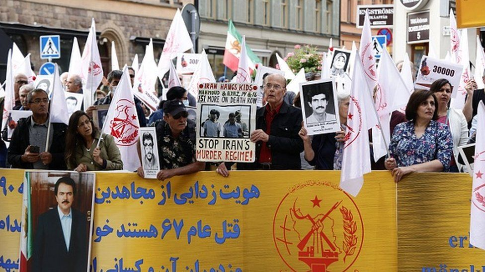 Supporters of an Iranian opposition group protest outside Stockholm's district court in Sweden
