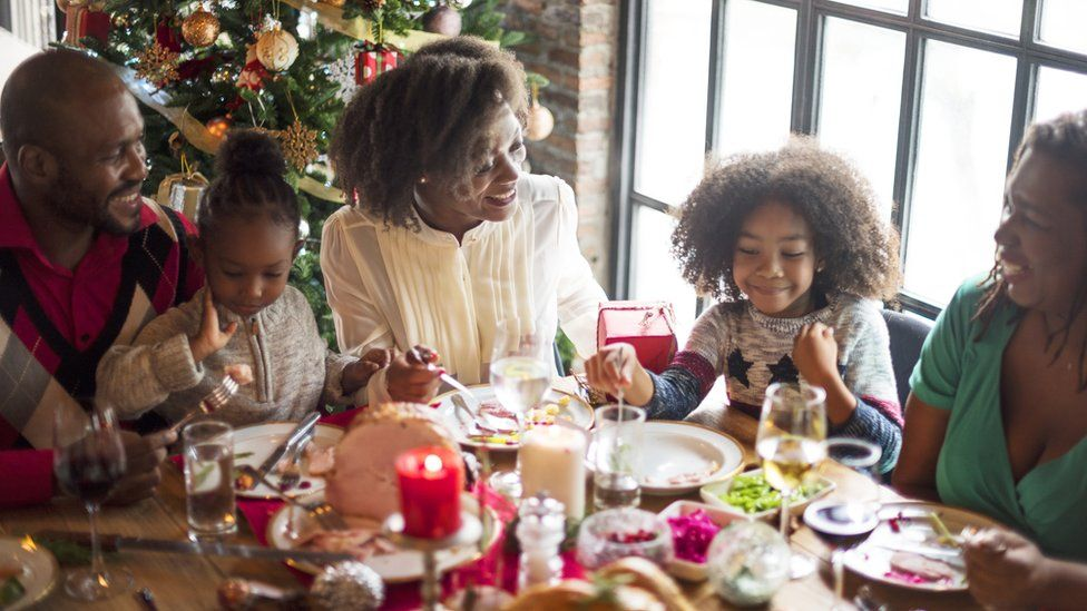 A family enjoying a festive celebration
