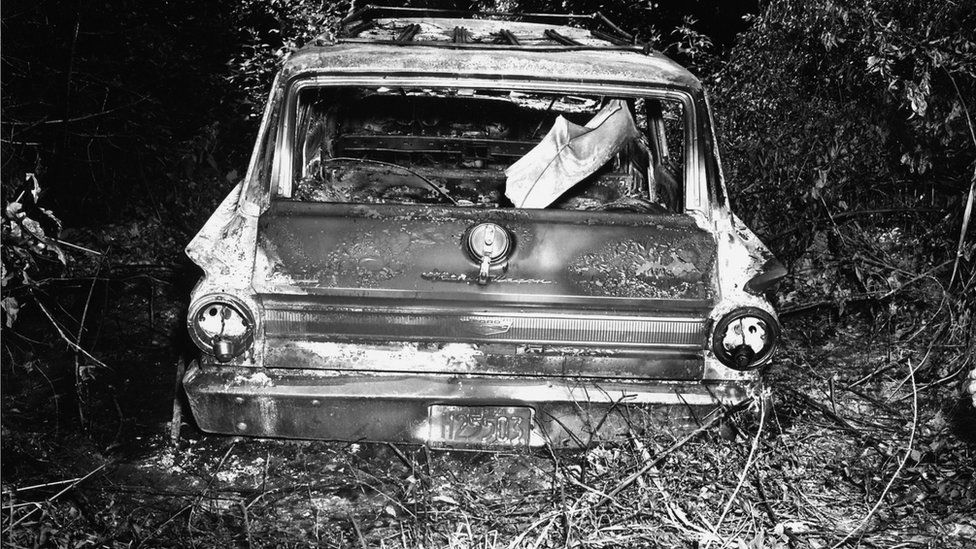 Burned out wreckage of the men, in black and white image released by the FBI
