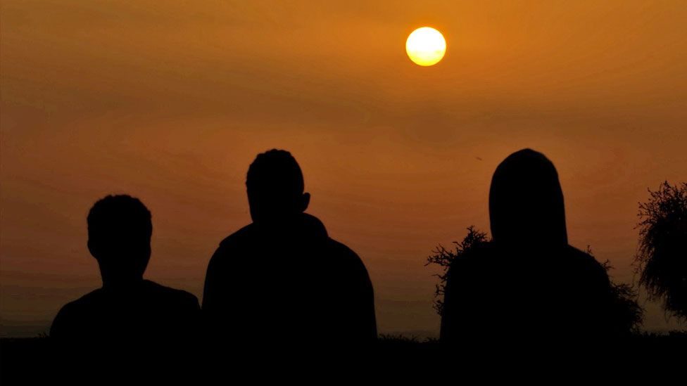 Silhouettes of refugees