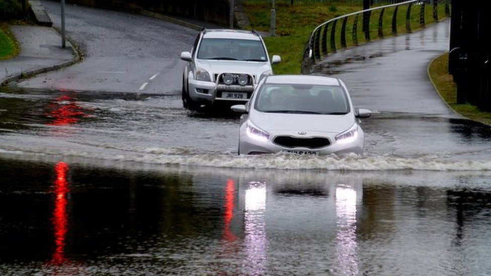 Motorists driving through the flooded Irishtown Road in Omagh