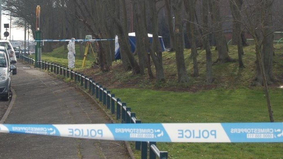 Forensic officer next to tent