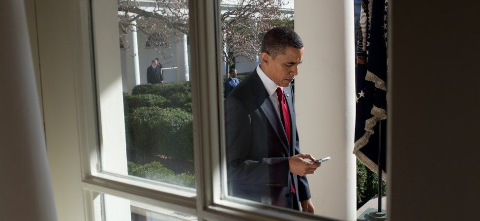 Obama on his Blackberry