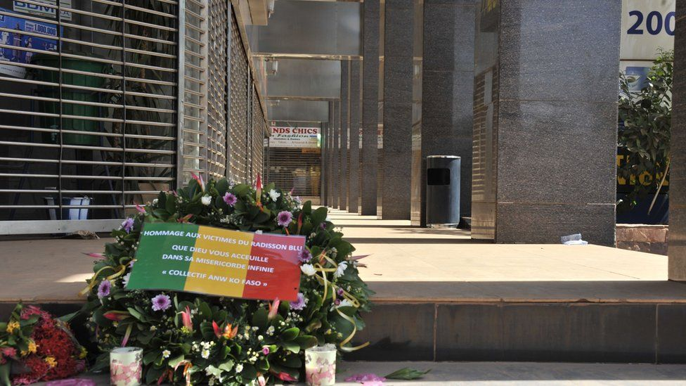 Flowers have been laid at the entrance the Radisson Blu hotel in Bamako on 24 November 2015