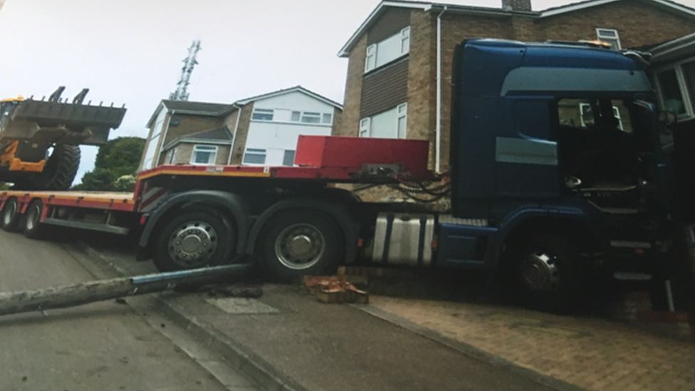 The lorry was carrying digger at the time of the crash