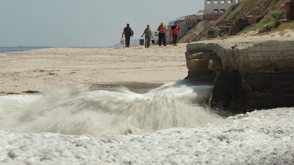 Sewage runs into the Mediterranean Sea on the coast of Gaza