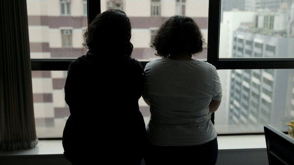 Sisters from Saudi Arabia, who go by aliases Reem and Rawan, are pictured at an office in Hong Kong on 23 February
