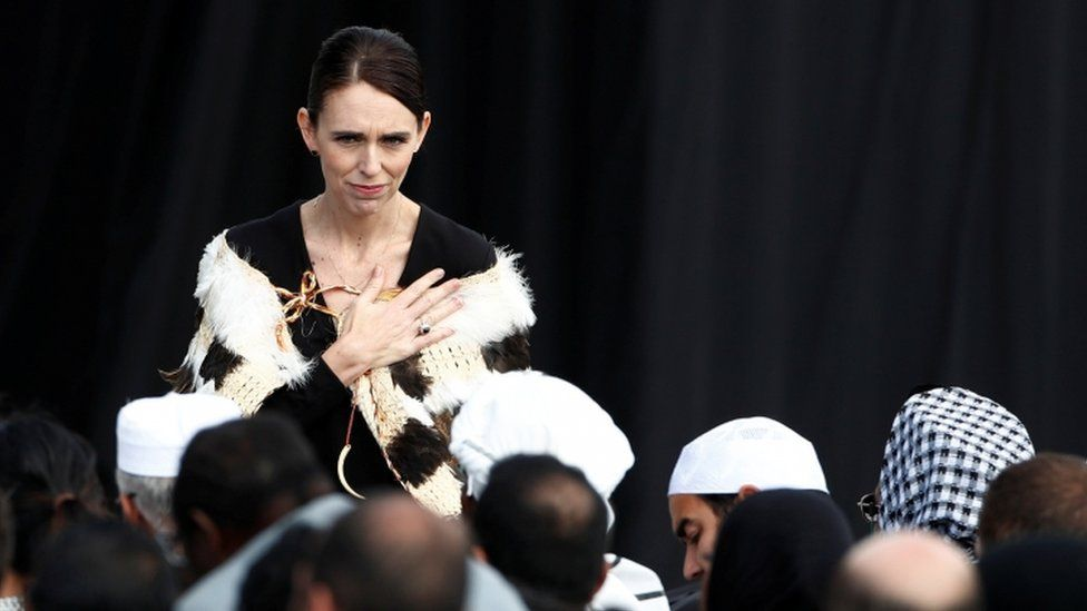 New Zealand's prime minister, Jacinda Ardern, speaking directly and gesturing to relatives of victims of the mosque attacks in Hagley Park on March 29