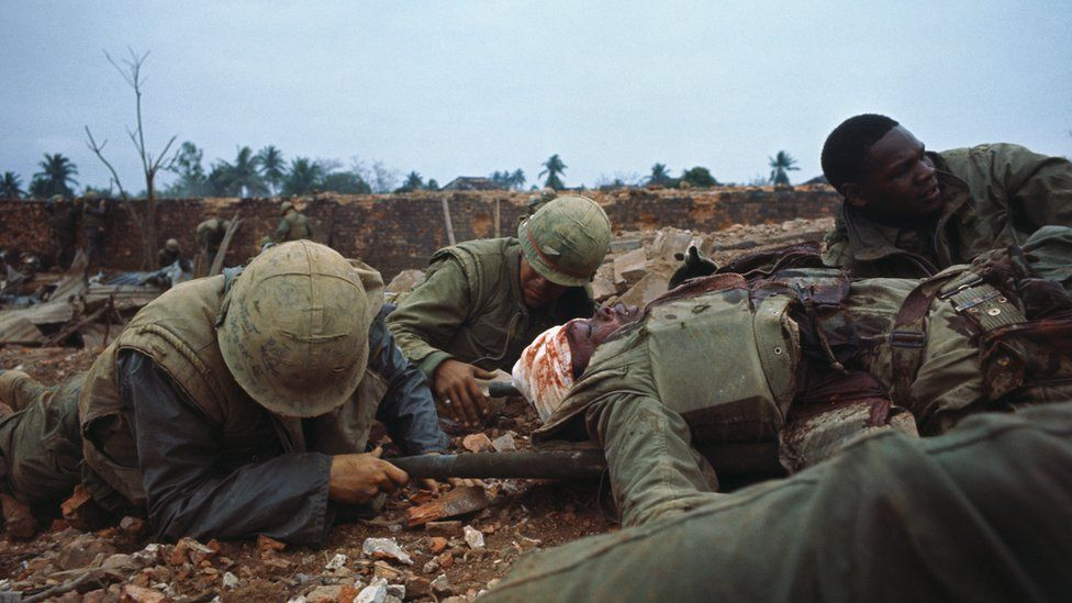 US Marines push one of their wounded out of range during the Vietnam war