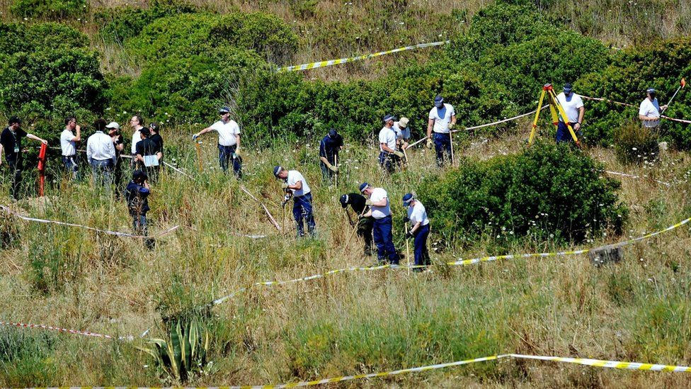 Police searching in long grass and bushes