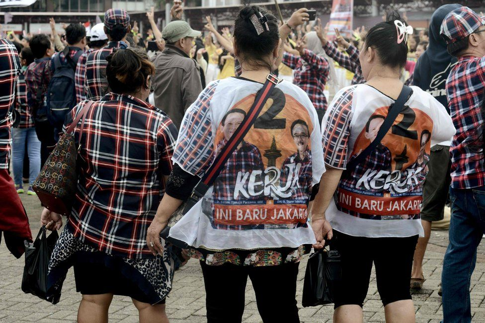 This picture taken on February 11, 2017 shows supporters wearing T-shirts in support of Jakarta's governor Basuki Tjahaja Purnama and his running mate Djarot Saiful Hidayat during their final campaign rally in Jakarta.