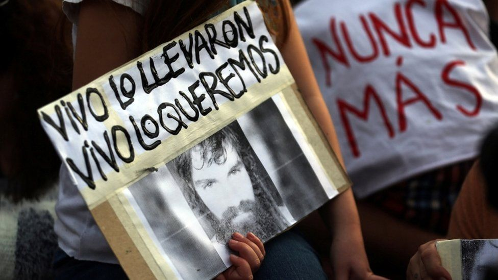 A girl holds a portrait of Santiago Maldonado, a protester who has been missing since security forces clashed with indigenous activists in Patagonia one month ago, during a demonstration to demand actions to find him in Buenos Aires, Argentina September 1, 2017
