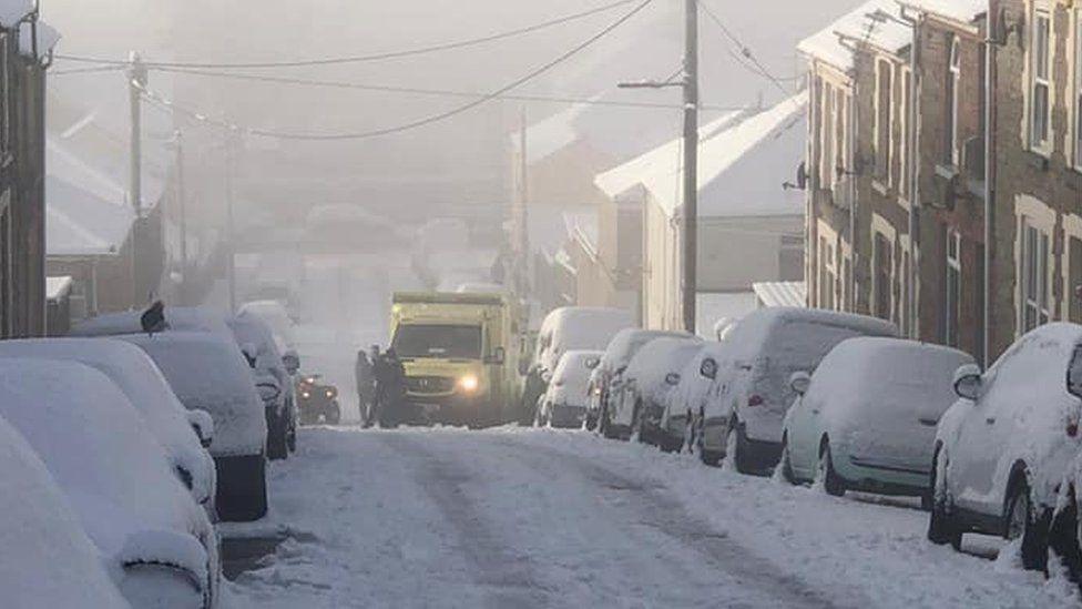 Ambulance stuck in snow