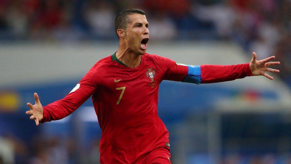 "Portugal""s Cristiano Ronaldo celebrates scoring their third goal against Spain"