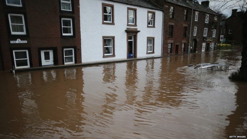 Flooded street in Cumbria last December