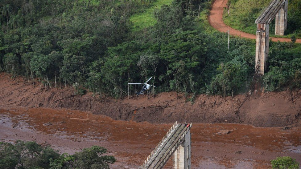Aerial view taken after the collapse of a dam which belonged to Brazil's giant mining company Vale