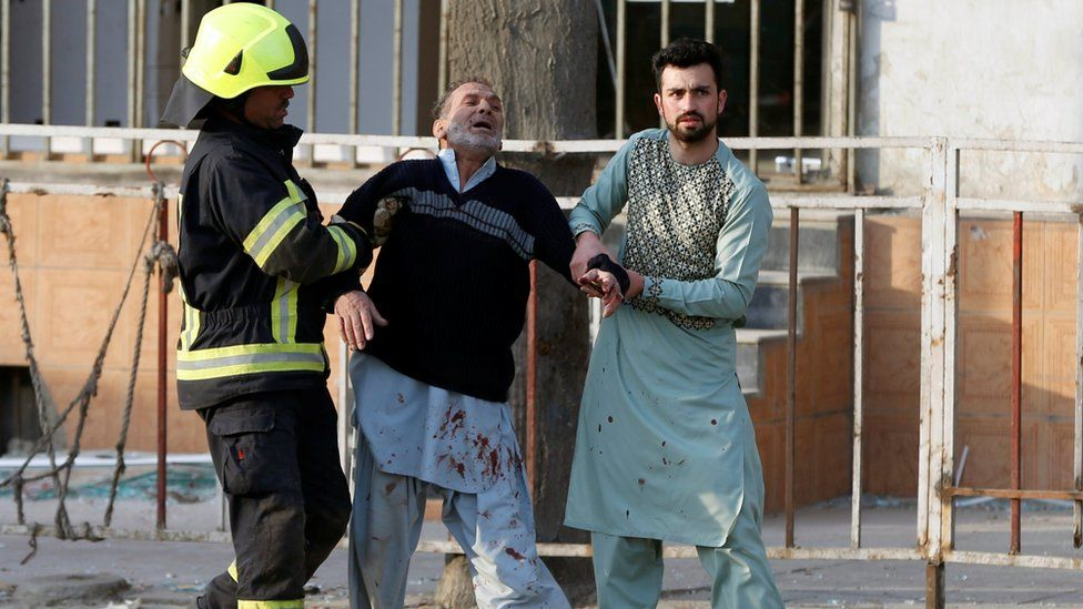 A man reacts after hearing his son was killed in a Kabul bombing, 27 January 2018