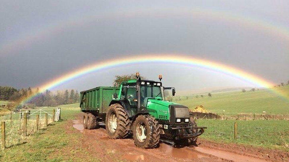 Double rainbow over tractor