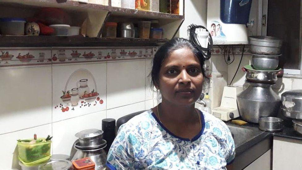 Shanthi standing in her kitchen