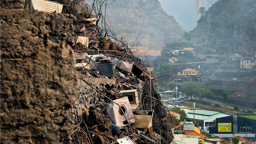 Charred debris from burned houses are pictured on the slopes of Campo da Barca, Funchal, Madeira island on 10 August 2016