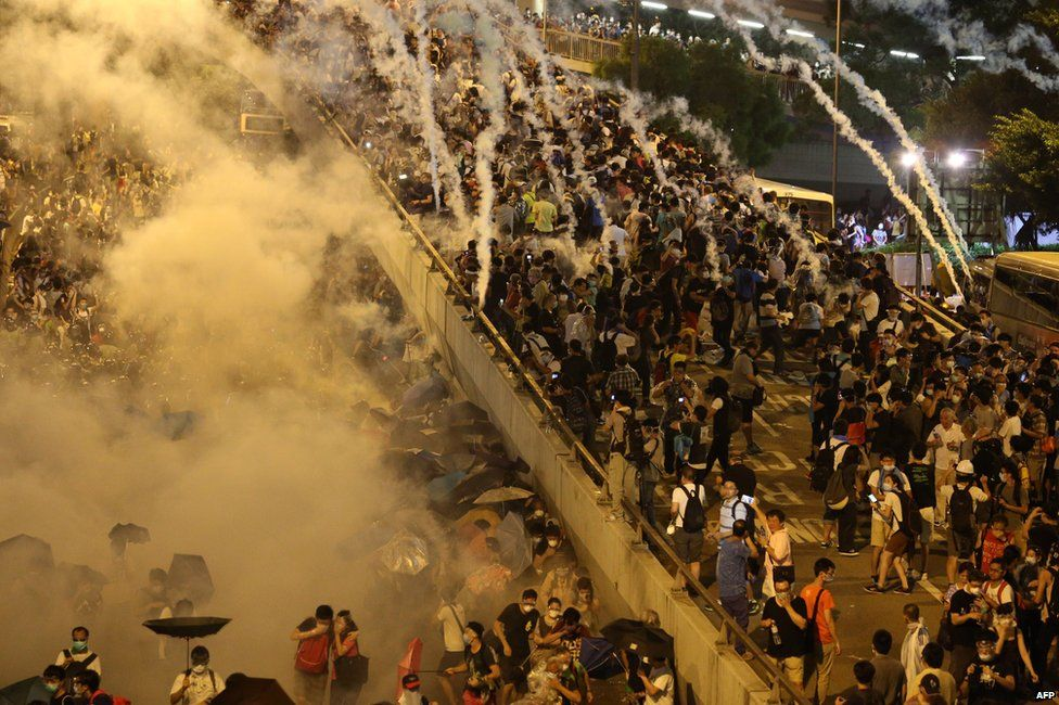 Police fire tear gas upon pro-democracy demonstrators near the Hong Kong government headquarters on 28 September 2014.