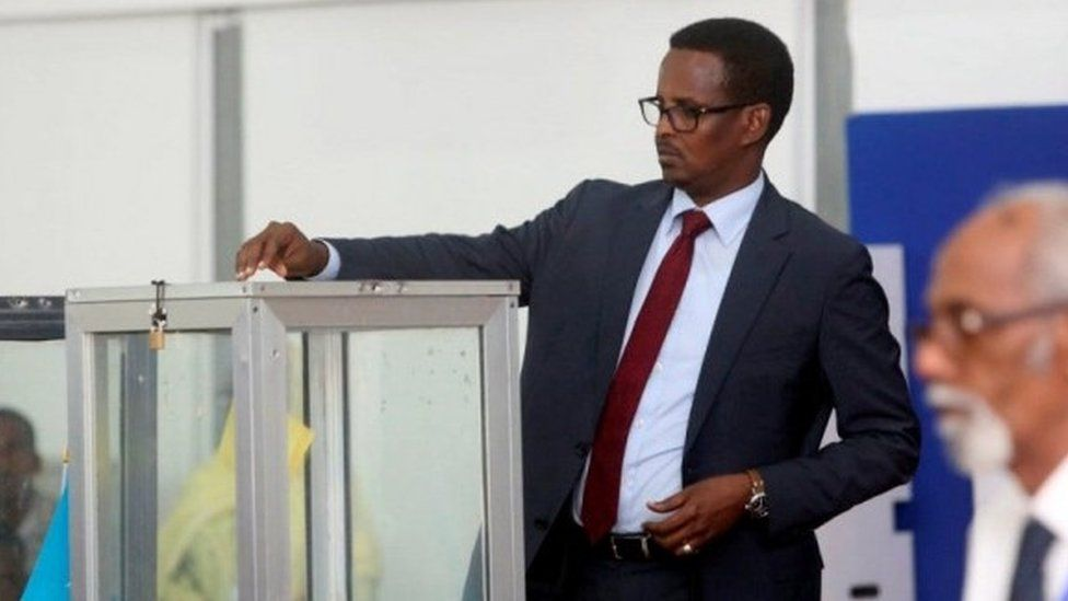 "A Somali lawmaker casts his ballot during the presidential vote at the airport in Somalia""s capital Mogadishu February 8, 2017."
