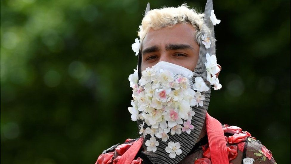 A participant dons a flower decorated face mask at the Black Trans Lives Matter rally in London