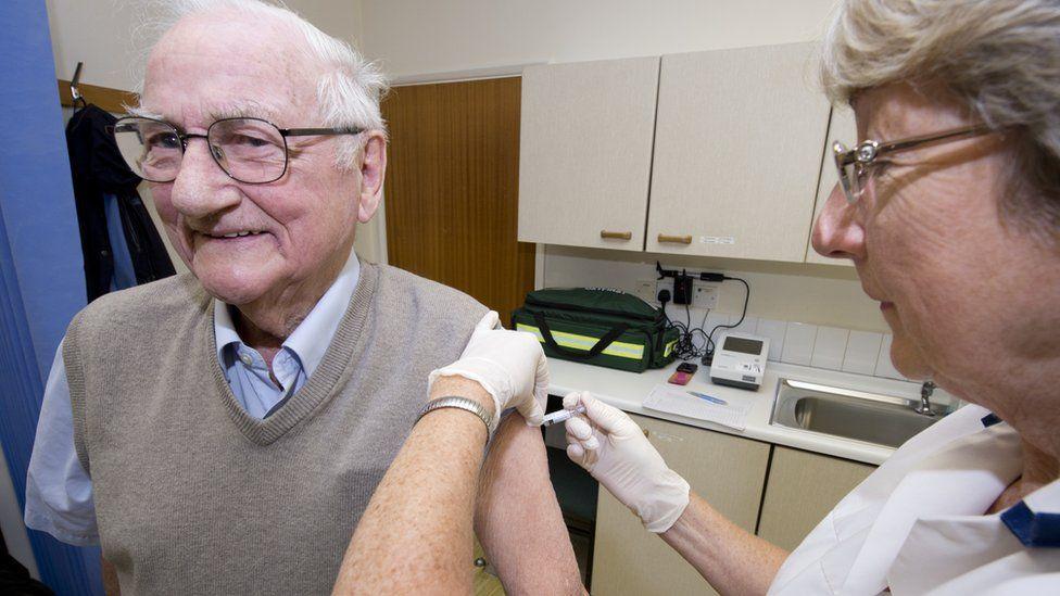 Elderly man gets flu jab