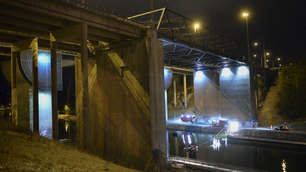 Divers and rescuers at the scene of a fatal crash in the canal under the E4 highway bridge in Sweden
