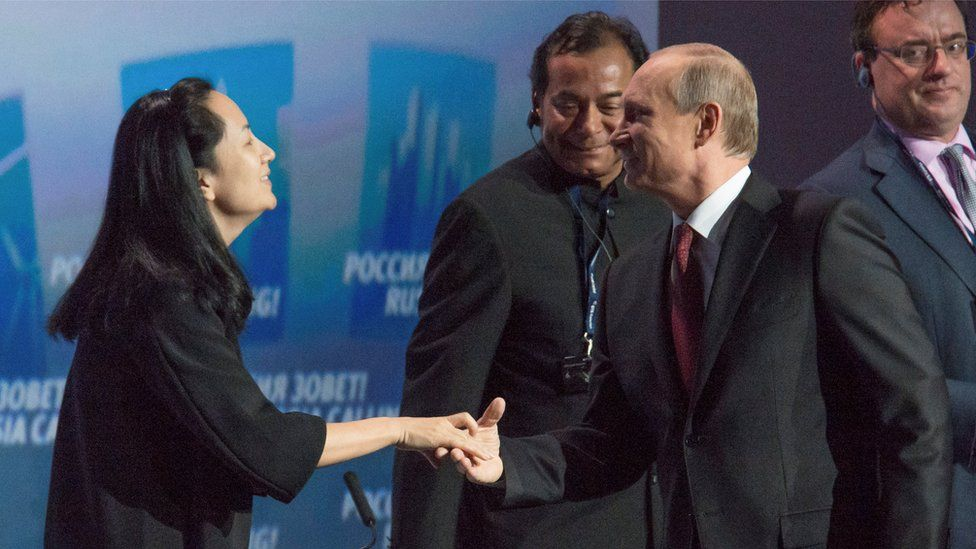 "Russia's President Vladimir Putin (R) greets Meng Wanzhou, of the Chinese technology giant Huawei, at the VTB Capital Investment Forum ""Russia Calling!"" in Moscow in October 2014"