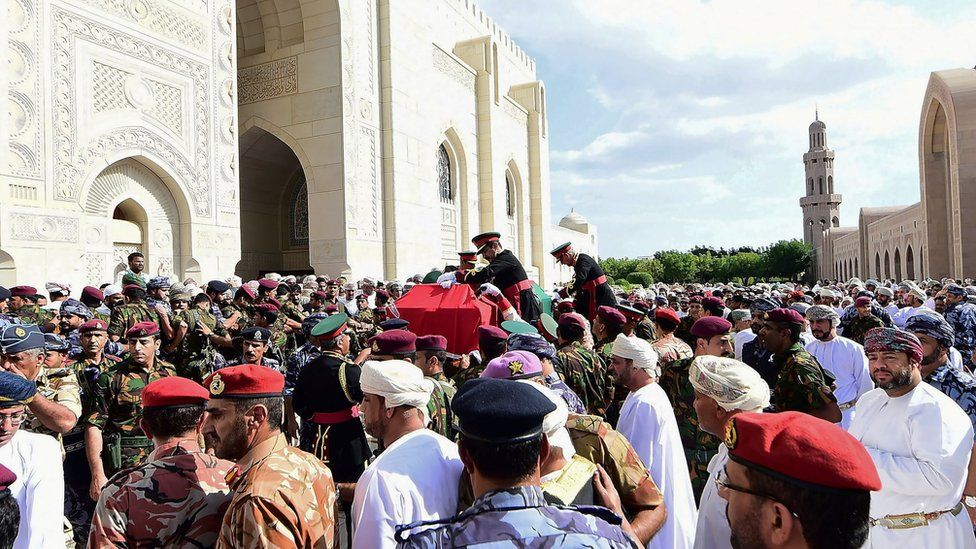 Mourners carry the coffin of late Sultan Qaboos during the funeral in Muscat