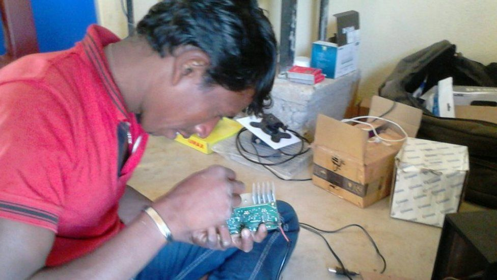 A villager repairs a part of the grid