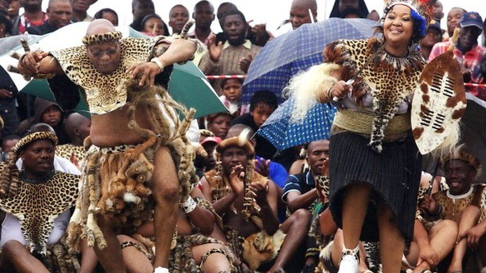 South African President Jacob Zuma (L) sings and dances with his newlywed Tobeka Madiba (R) at their wedding ceremony on January 4, 2010 in a colourful Zulu traditional wedding outfit at Zuma's rural homestead of Nkandla