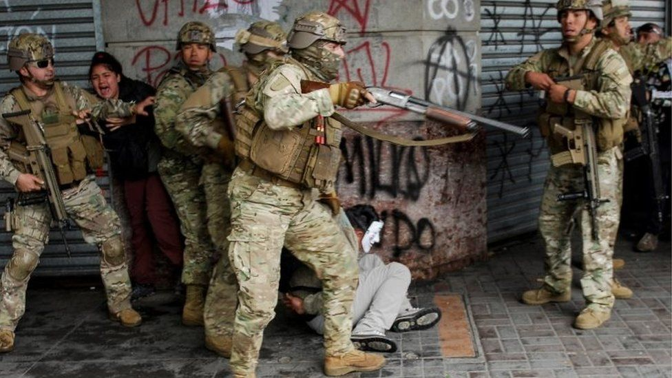 Security forces detain a demonstrator during anti-government protests, in Concepcion, Chile October 26, 2019.