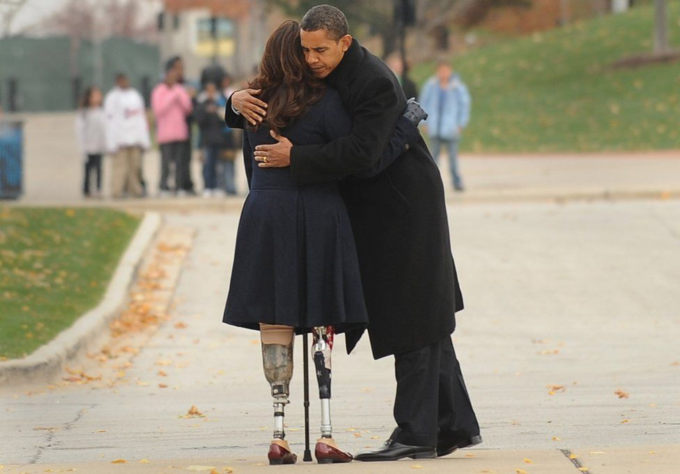 Barack Obama (L) embraces Iraqi war veteran and Illinois State Director of Veterans Affairs, Tammy Duckworth (R), - November 2008