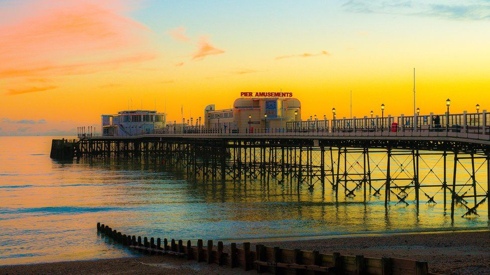 Worthing Pier bathed in a sunset glow