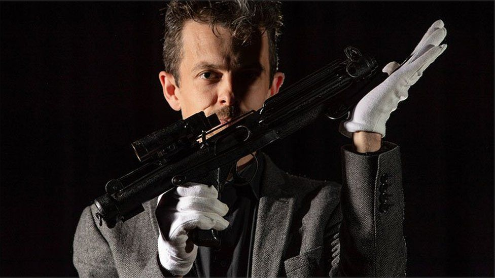 Jonathan Ferguson, Keeper of Firearms and Artillery with the 'Imperial Stormtrooper E-11 blaster'