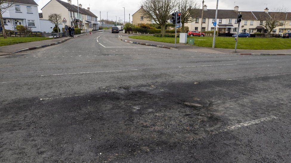 Scorched section of the Dungiven Road on 4 April where wooden pallets where set alight the night before
