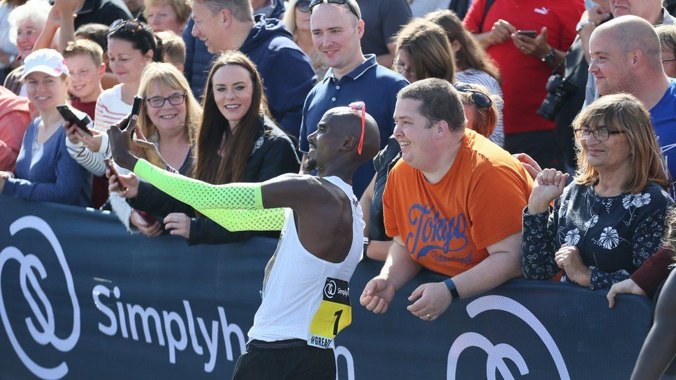 Sir Mo Farah takes a mobile phone selfie after winning the Great North Run