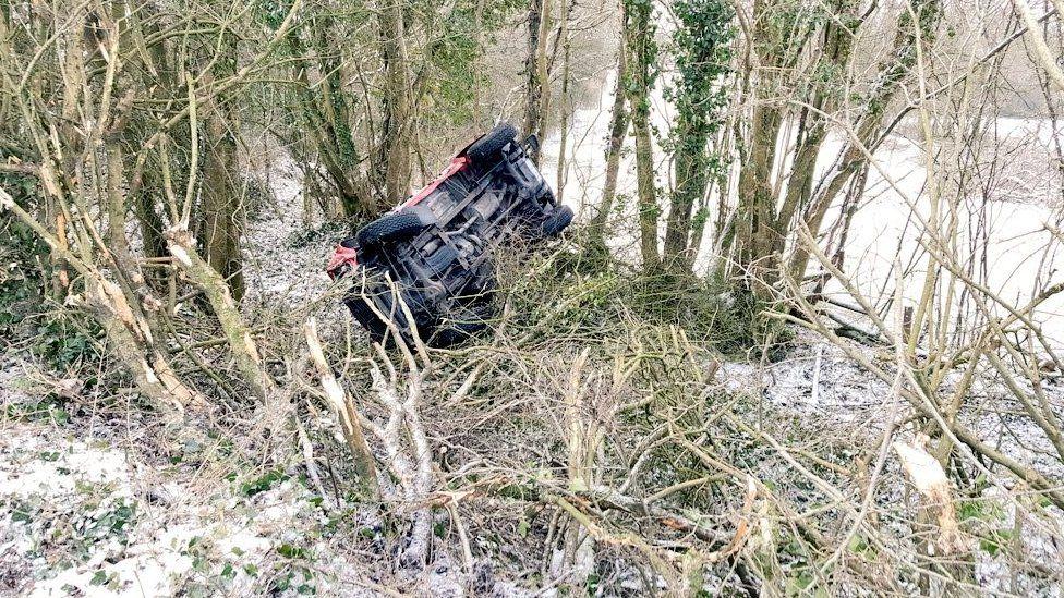 A 4x4 overturned in Bridgend