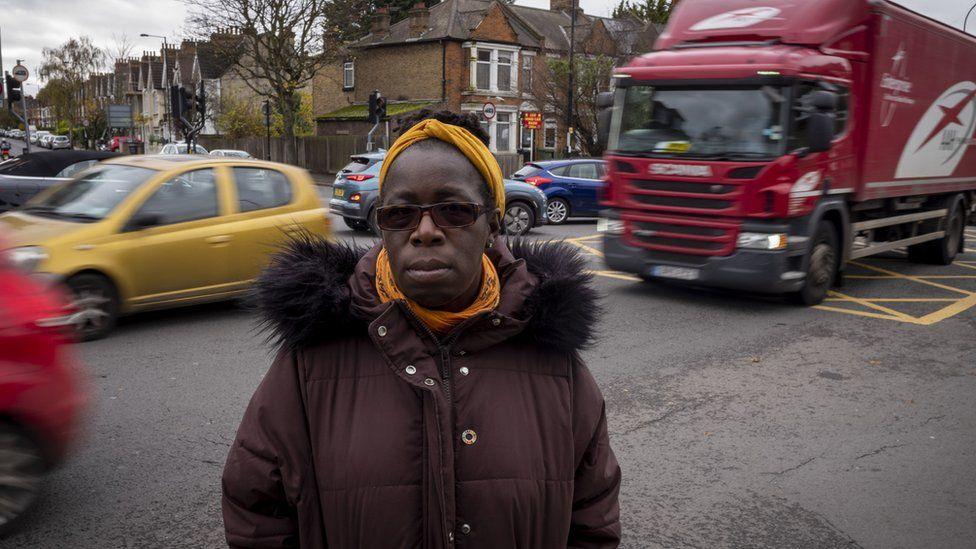 Rosamund Adoo-Kissi-Debrah as she stands next to A205 South Circular