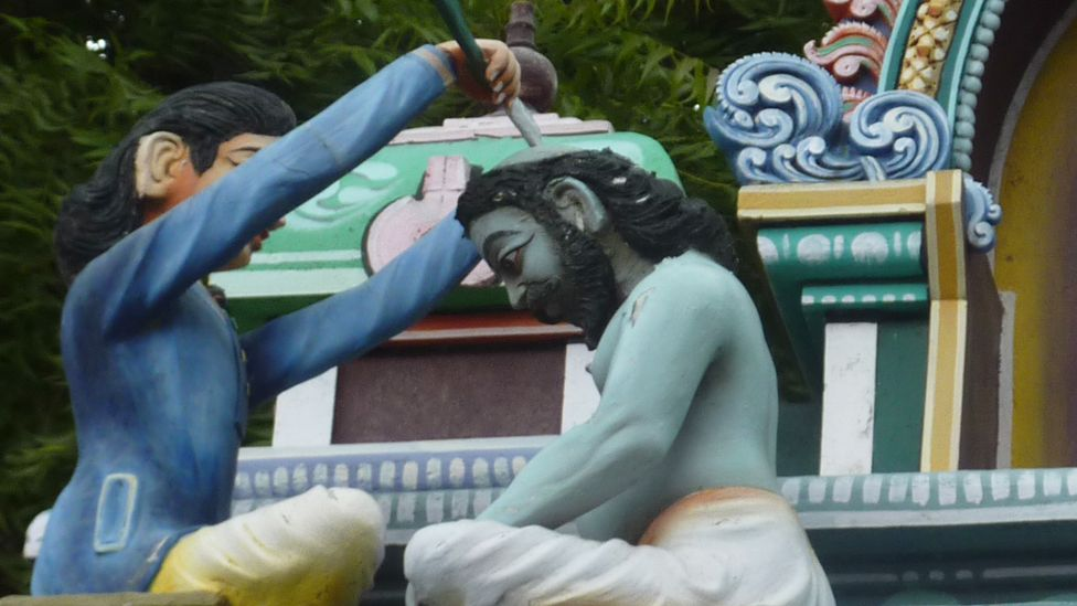 A statue on a Hindu temple reveals how tonsuring in an ancient tradition