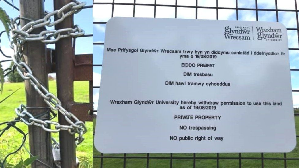 Locked gate and sign at Glwyndwr University owned field in Rhosnesni