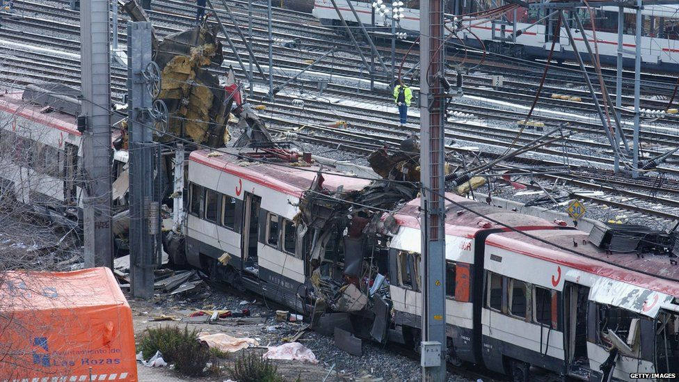 The wreckage of a train in Madrid in 2004, after terrorists detonated three bombs