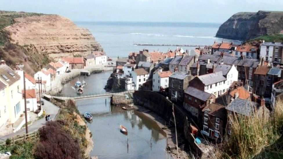 North East Ambulance Service was called at 16:18 BST to the beach at Staithes, North Yorkshire