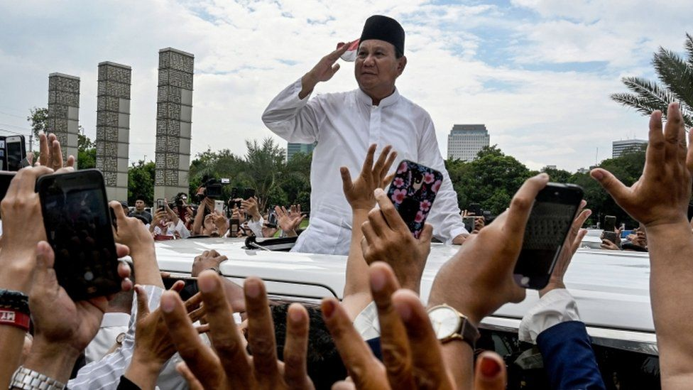 Indonesia's presidential candidate Prabowo Subianto gestures to supporters as he leaves a mosque after Friday prayers in Jakarta on 19 April, 2019