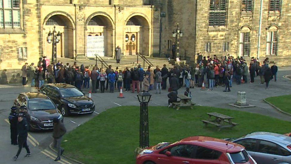 Protestors outside the university
