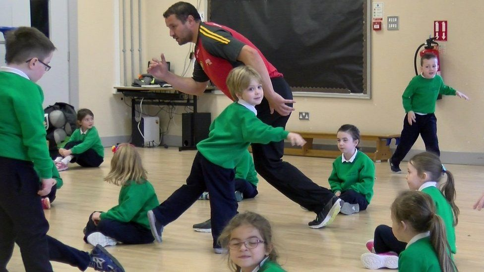 Primary school children playing 'freeze'