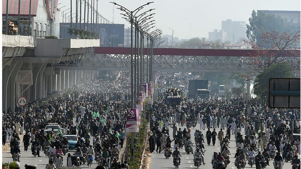 Thousands of protesters marching towards the centre of Islamabad
